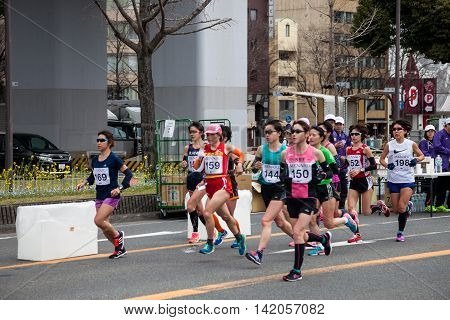NAGOYA JAPAN - MARCH 13 2016: Nagoya Women's Marathon 2016. Women's running in the downtown. Course Start and finish at Nagoya Dome Distance 42.195km. Nagoya city Japan.