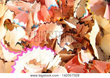 Pencil shavings - colorful abstract background on the subject of school