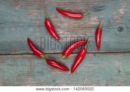 Red spicy peppers on a wooden table stock pictures