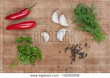Herbs, pepper, garlic and oil stock picture