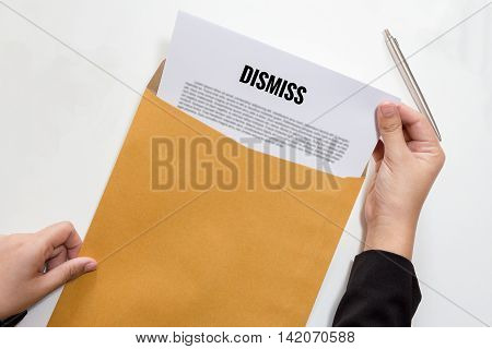 Businesswoman hands holding the dismissed document in envelope - fired business concept