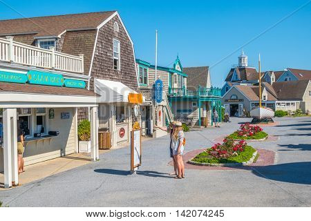 MONTAUK, LONG ISLAND, US, JUNE 18, 2016: Tourists study menu of restaurant in center of Montauk village