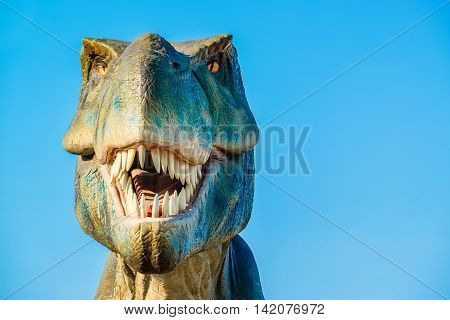 NOVI SAD SERBIA - AUGUST 5 2016: Tyrannosaurus life size model of prehistoric animal in theme entertainment Dino Park. T-rex was one of the largest land carnivores of all time.