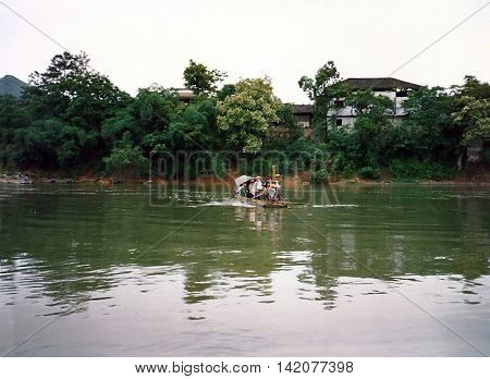 GUILIN / CHINA - CIRCA 1987: People embark on a small raft on the Li River from Guilin.