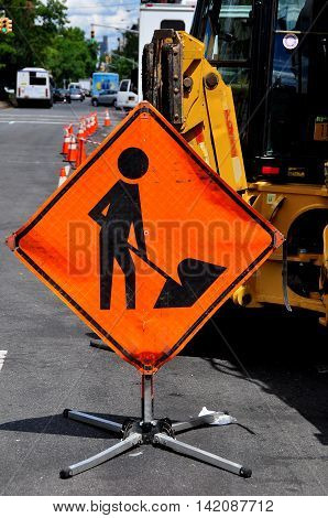 New York City - August 13 2015: Orange men at work sign at a Con Edison construction site on Broadway and West 145th Street