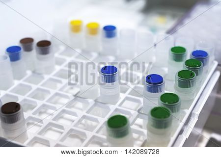 Rows Of Plastic Vials In The Tray Automatic Liquid Dispenser.