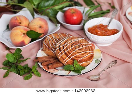 Two buns with cinnamon apple snails and apricots still life