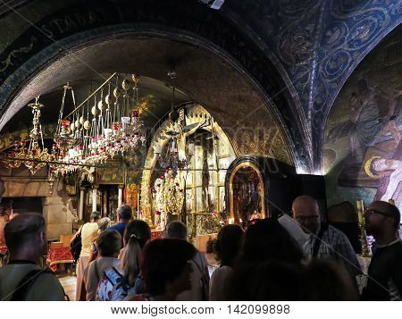 JERUSALEM - Juli 15: Stone Golgotha the place of Jesus' death in the Basilica of the Holy Sepulchre the holiest place of Christians July 15 2015 in Jerusalem Israel