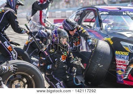 Watkins Glen, NY - Aug 07, 2016: Denny Hamlin brings the #11 FedEx Freight Toyota into the pits for maintenance  during the CHEEZ-IT 355 at Watkins Glen International in Watkins Glen, NY.