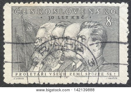 MOSCOW RUSSIA - CIRCA APRIL 2016: a post stamp printed in CZECHOSLOVAKIA shows portrait of Marx Engels Lenin and Stalin the series