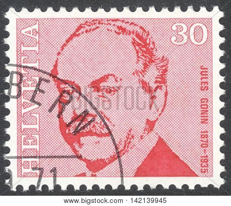 MOSCOW RUSSIA - CIRCA APRIL 2016: a post stamp printed in SWITZERLAND shows a portrait of Jules Gonin the series