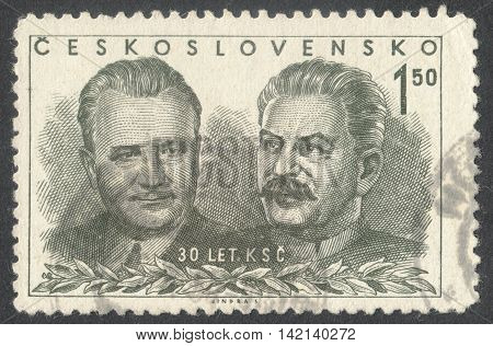 MOSCOW RUSSIA - CIRCA APRIL 2016: a post stamp printed in CZECHOSLOVAKIA shows portrait of Gottwald and Stalin the series