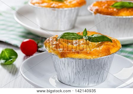 French dish julienne. Mushroom chicken and cheese gratin in Aluminum Foil Mini Baking Cups authentic recipe