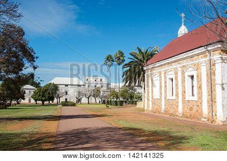 NEW NORCIA,WA,AUSTRALIA-JULY 15,2016: The Abbey Church of the Holy Trinity and front of the white Benedictine Monastery in the historic monastic town of New Norcia, Western Australia.