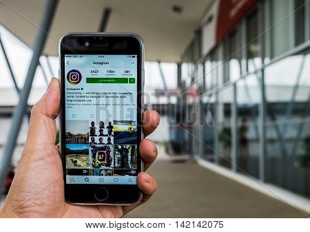 Stock Photo: CHIANG MAI THAILAND - MAY 292016: A man holds Iphone 6s or 6s Plus with Instagram application on the screen. Instagram is a photo-sharing app for smartphones.