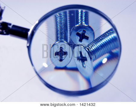 Screws Under A Magnifier In  Blue Color