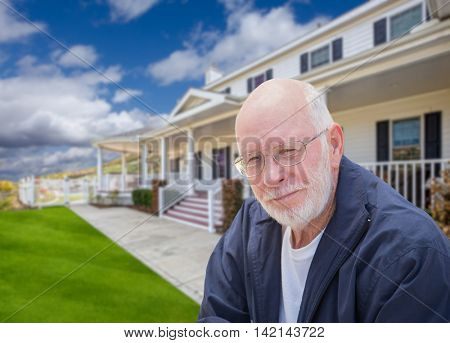 Senior Adult Man in Front of Beautiful House.