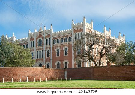 NEW NORCIA,WA,AUSTRALIA-JULY 15,2016: Exterior of the brick Spanish gothic St. Ildephonsus College for Boys in the historic monastic town of New Norcia, Western Australia.