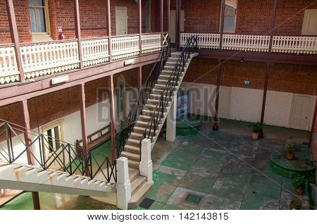 NEW NORCIA,WA,AUSTRALIA-JULY 15,2016: Outdoor courtyard with balcony and double stairway at St. Ildephonsus College for Boys in the historic monastic town of New Norcia, Western Australia.