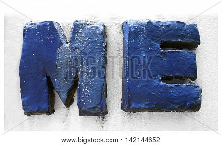 cement sculpture ME English word retro style on wall.