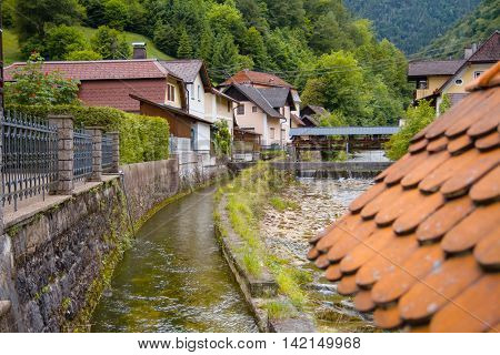 Beautiful austrian village with mountains river in summer