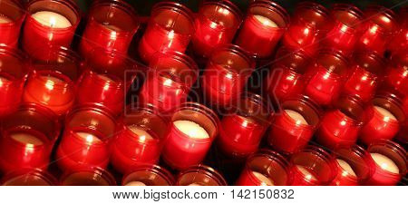 Many Red Flames Of Candles Lit By The Faithful In The Place Of W