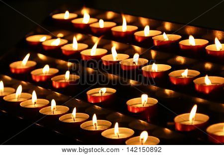 Many Candles Lit With Flickering Flame