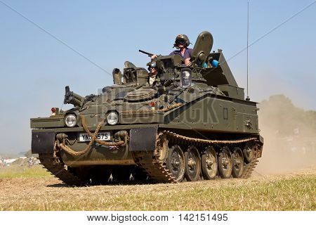 WESTERNHANGER, UK - JULY 20: An ex British army Alvis Striker fighting vehicle gives a display around the main arena at the War & Peace Revival show on July 20, 2016 in Westernhanger