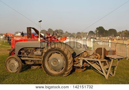 WESTERNHANGER, UK - JULY 20: A civilian vintage field tractor is put on public display on the main concourse at the War & Peace Revival show on July 20, 2016 in Westernhanger