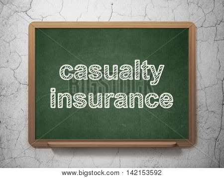 Insurance concept: text Casualty Insurance on Green chalkboard on grunge wall background, 3D rendering