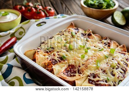 Chicken Enchiladas With Spicy Tomato Sauce, Corn, Beans And Cheese