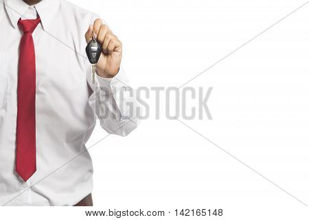 Young Successful Businessman Offering A Car Key. Close-up Of Driver's Hand Showing Key Of His Own Au
