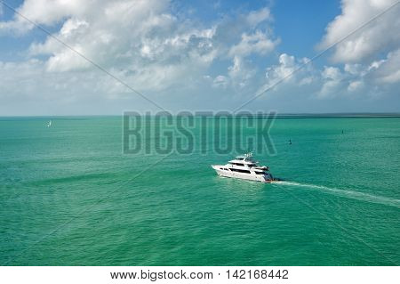 Yacht Floating On Green Water