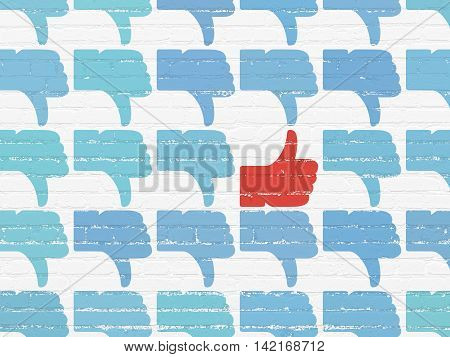 Social media concept: rows of Painted blue thumb down icons around red thumb up icon on White Brick wall background
