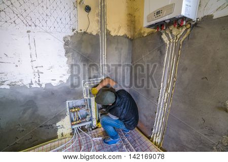 pipefitter installing system of heating