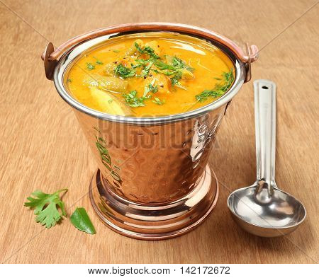 Indian sambar, a traditional and popular semi-liquid food, for rice and chapati, made with vegetables, lentils and sambar powder.