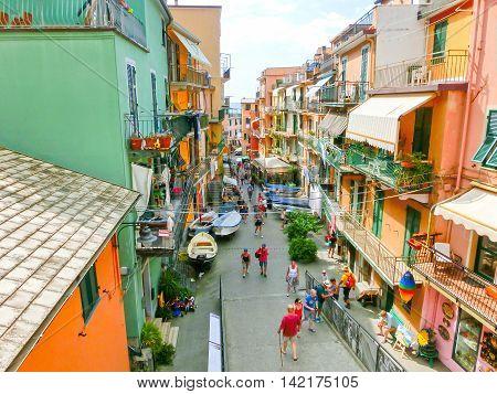 Riomaggiore Italy - September 09 2015: Central street of Riomaggiore a village in province of La Spezia Liguria Italy. Cinque Terre UNESCO World Heritage Site