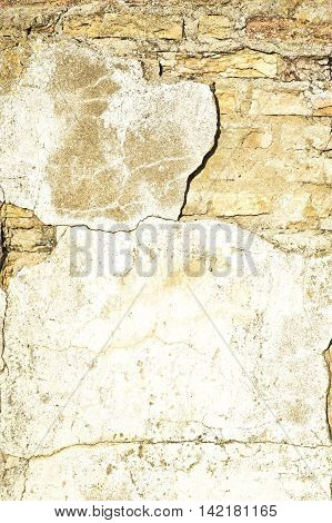 Decaying weathered cement brick wall with blank space for text