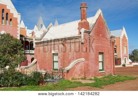 NEW NORCIA,WA,AUSTRALIA-JULY 15,2016: St. Gertrude's Ladies College rear view with red brick Spanish gothic architecture under a blue sky in the monastic town of New Norcia, Western Australia.