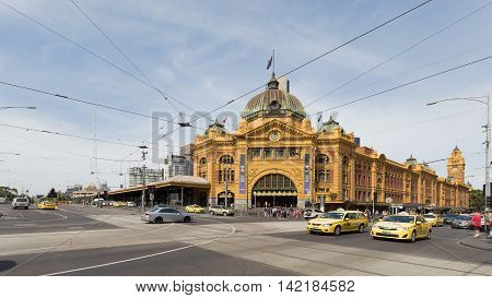 Melbourne - February 23 2016: The main entrance to the railway station Flinders Street Station with a clock and a lot of people and cars around February 23 2016 Melbourne Australia