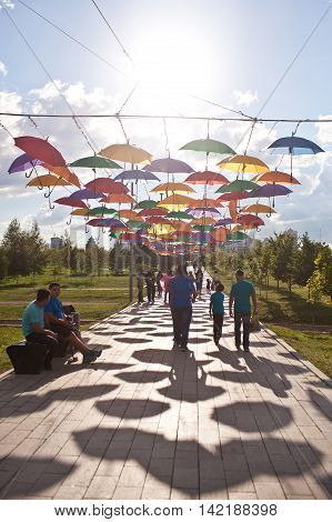 ASTANA, KAZAKHSTAN  - 14 JULY, 2016: Installation from multi-colored umbrellas in the park.