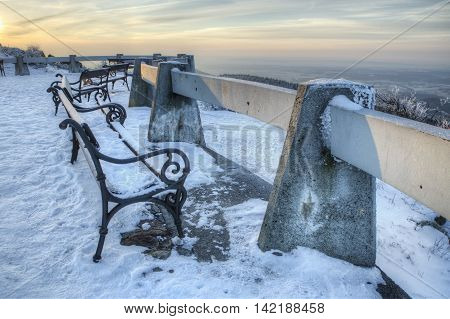 Jested - bench on the patio overlooking the winter landscape.. Liberec Bohemia Czech Republic. Beautifull morning