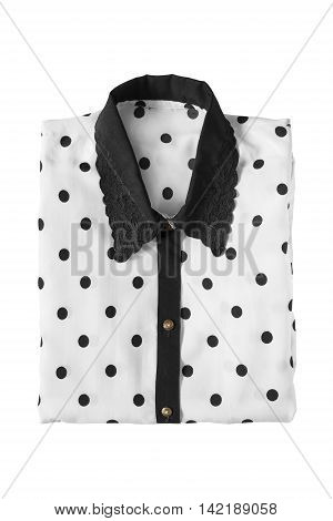 Black and white silk blouse folded on white background