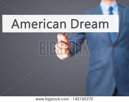 American Dream - Businessman Hand Holding Sign