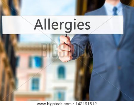 Allergies - Businessman Hand Holding Sign