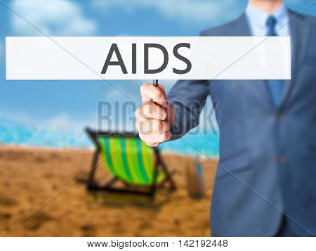 Aids - Businessman Hand Holding Sign