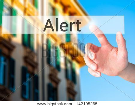 Alert - Hand Pressing A Button On Blurred Background Concept On Visual Screen.