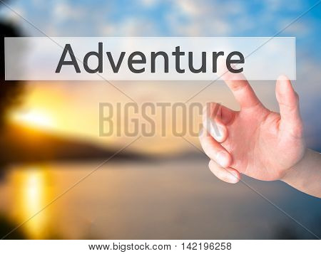 Adventure - Hand Pressing A Button On Blurred Background Concept On Visual Screen.