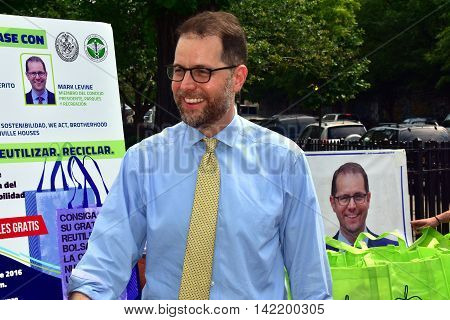 New York City - May 27 2016: District 7 NYC Council Member Mark Levine at an environmental free reuseable shopping bag giveaway in Hamilton Heights