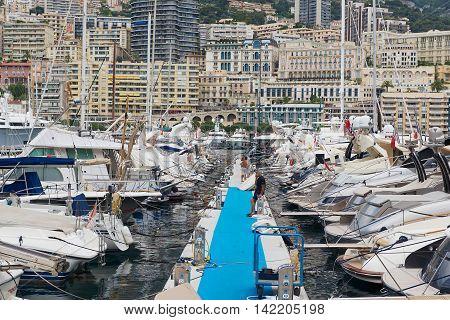 MONACO, MONACO - JUNE 06, 2015: View to the boats tied in the Monte Carlo harbor Monaco, Monaco.